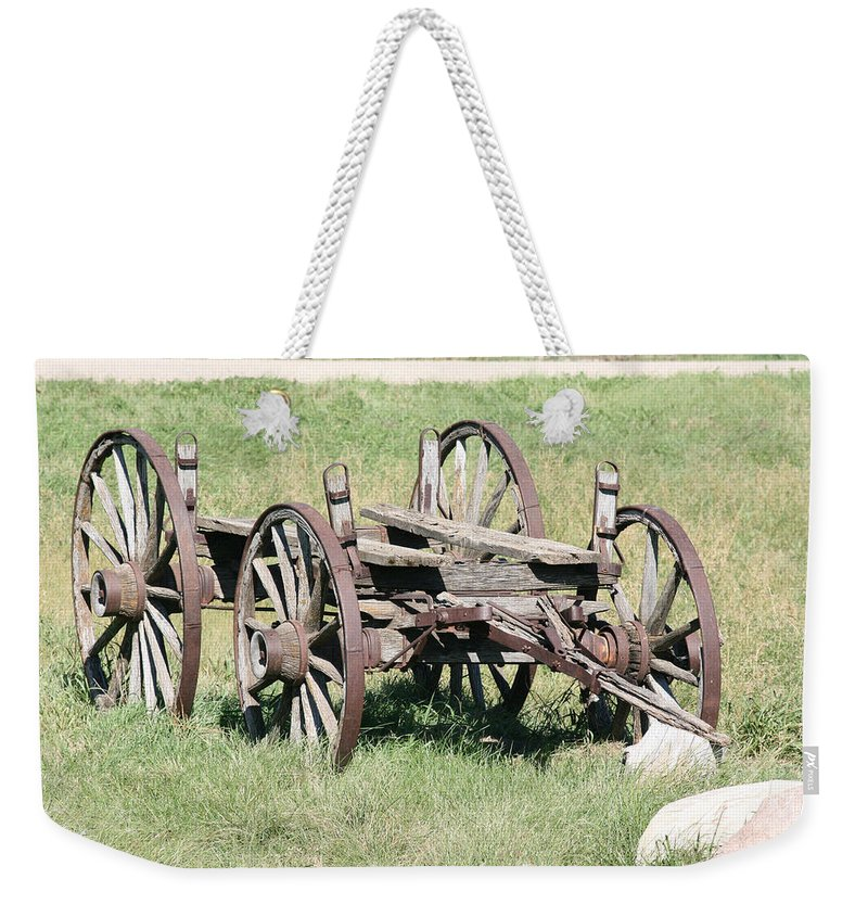 Old Wagon Ranch Horse Drawn Antique Wheels History Weekender Tote Bag featuring the photograph Wagon Aged by Andrea Lawrence