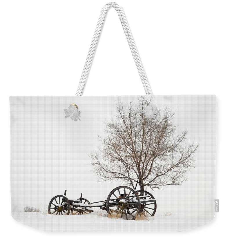 Wagon Weekender Tote Bag featuring the photograph Wagon In The Snow by Dave Rennie