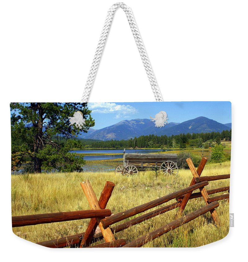 Landscape Weekender Tote Bag featuring the photograph Wagon West by Marty Koch