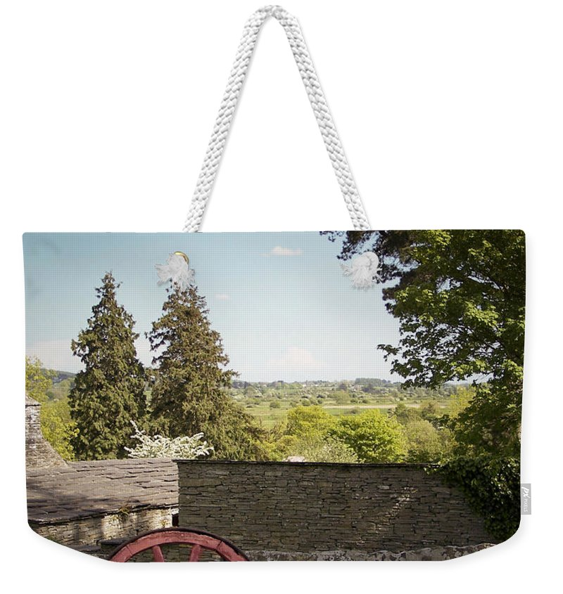 Irish Weekender Tote Bag featuring the photograph Wagon Wheel County Clare Ireland by Teresa Mucha