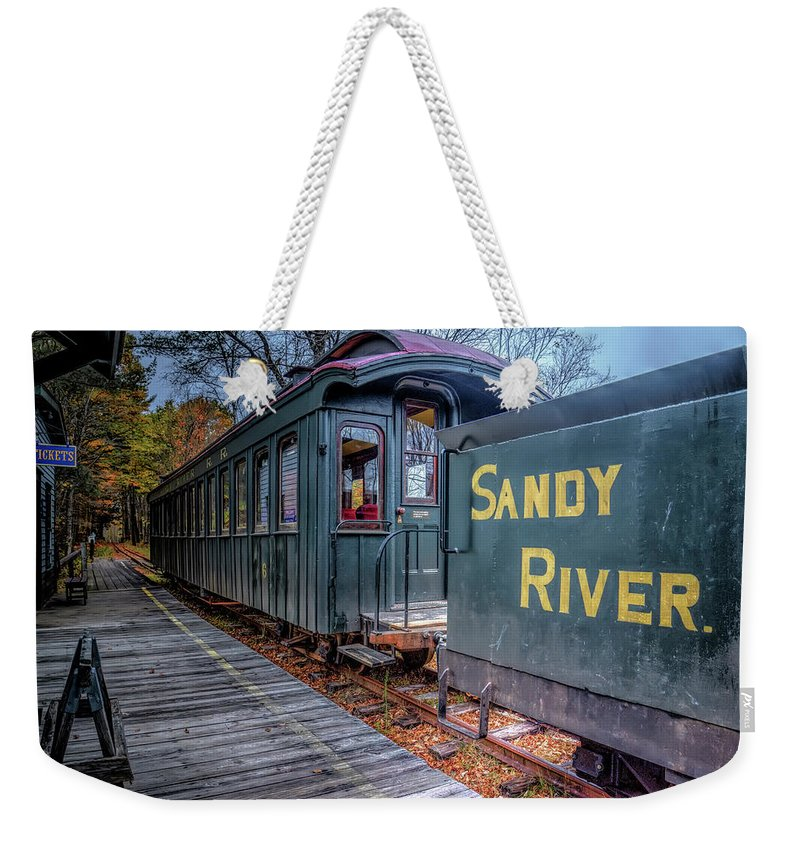 Train Weekender Tote Bag featuring the photograph Waiting At The Station by Jeff Cooper
