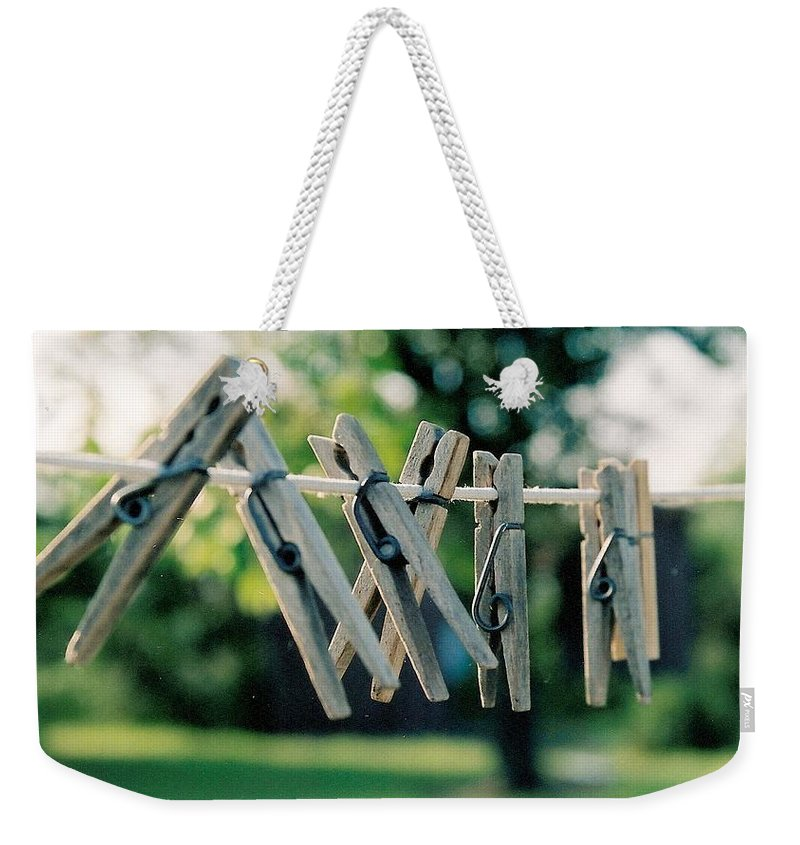 Clothes Pins Weekender Tote Bag featuring the photograph Waiting For Work by Lauri Novak