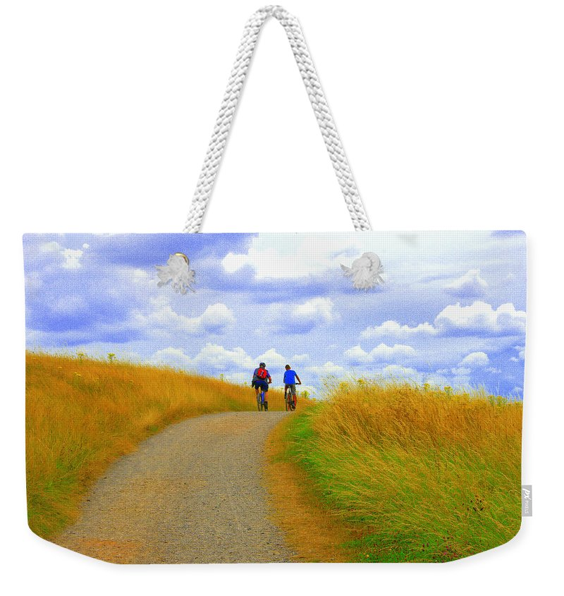 Couple Weekender Tote Bag featuring the photograph Cyclists by Gordon James