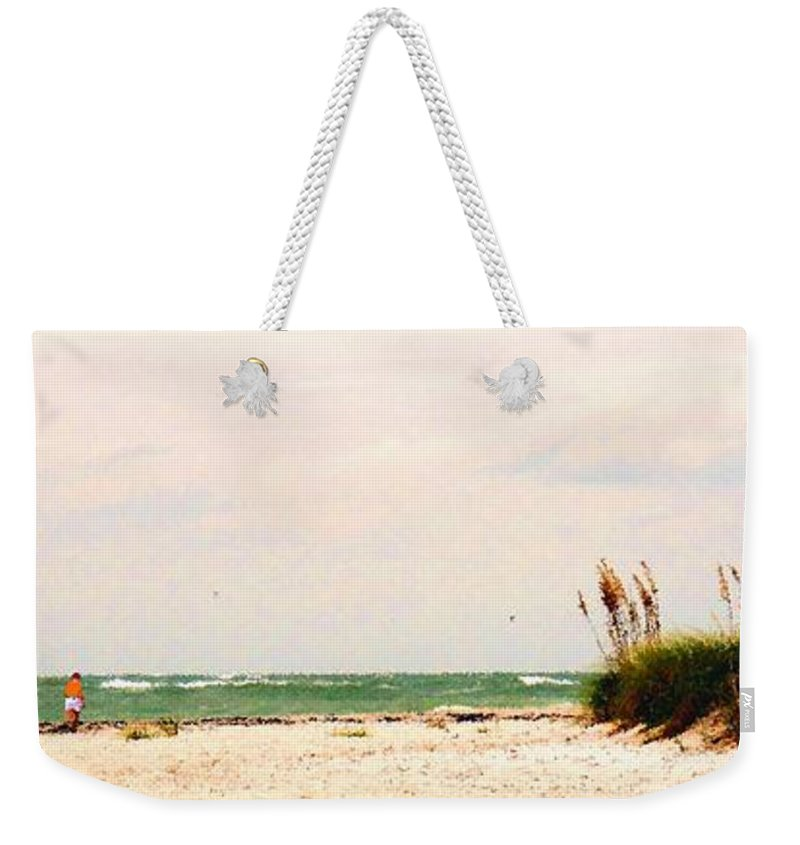 Florida Weekender Tote Bag featuring the photograph Walking The Beach by Ian MacDonald