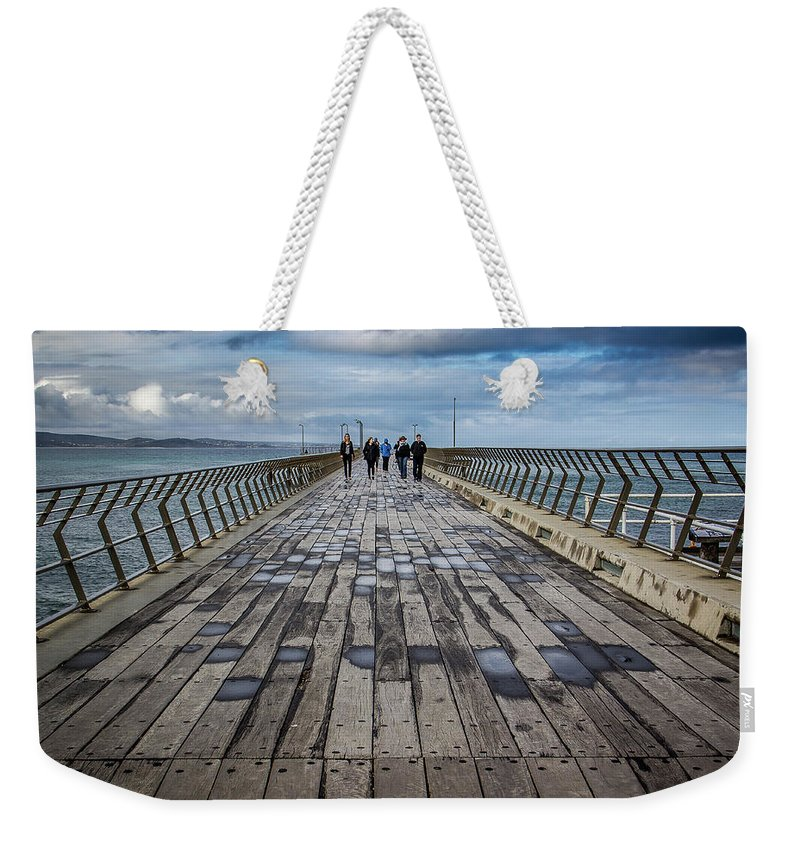 Pier Weekender Tote Bag featuring the photograph Walking The Pier by Perry Webster