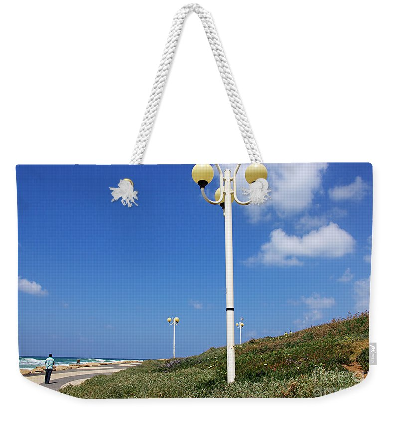 Tel Aviv Weekender Tote Bag featuring the photograph walkway along the Tel Aviv beach by Zal Latzkovich