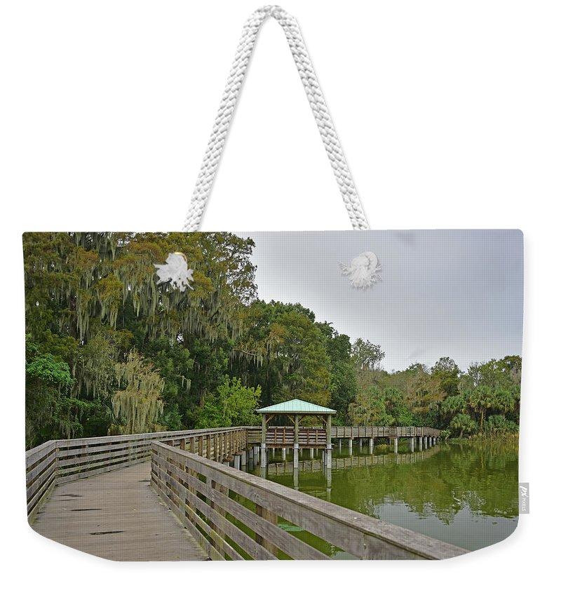 Landscapes Weekender Tote Bag featuring the photograph Walkway At Lake Dora by Deborah Good