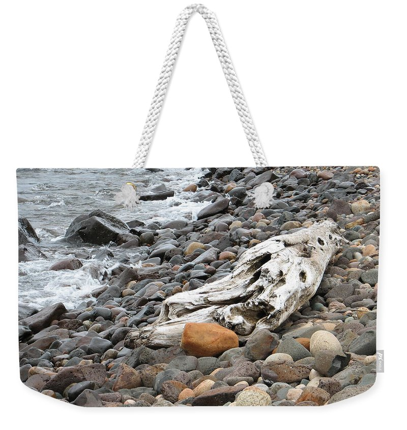 Driftwood Weekender Tote Bag featuring the photograph Washed Up by Kelly Mezzapelle