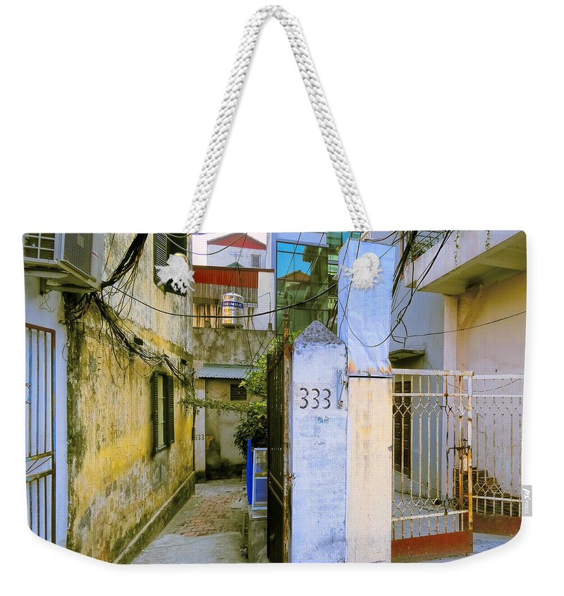 Apartment Weekender Tote Bag featuring the photograph Water And Electric Paid by Dominic Piperata