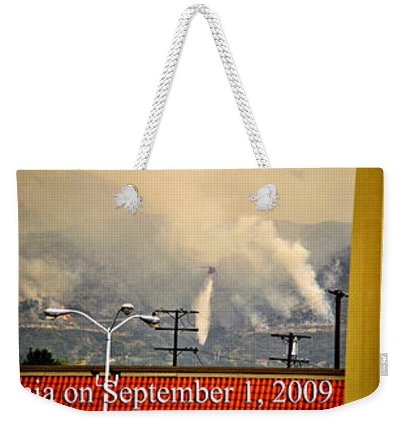 Clay Weekender Tote Bag featuring the photograph Water Drop On The Station Fire by Clayton Bruster