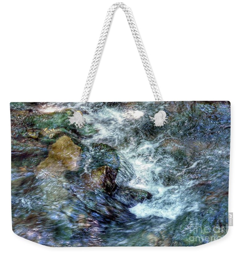 Water Flowing Over Rocks Weekender Tote Bag featuring the photograph Water In Motion by John Myers