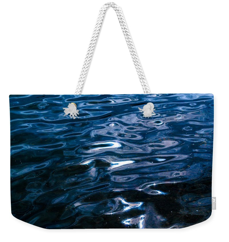 Abstract Weekender Tote Bag featuring the photograph Water Ripples On Surface by John Williams
