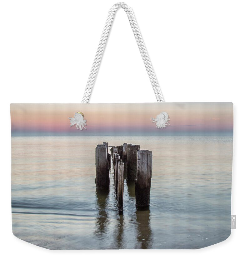 Water Weekender Tote Bag featuring the photograph Wave Break At Sunrise. by Steve Muth