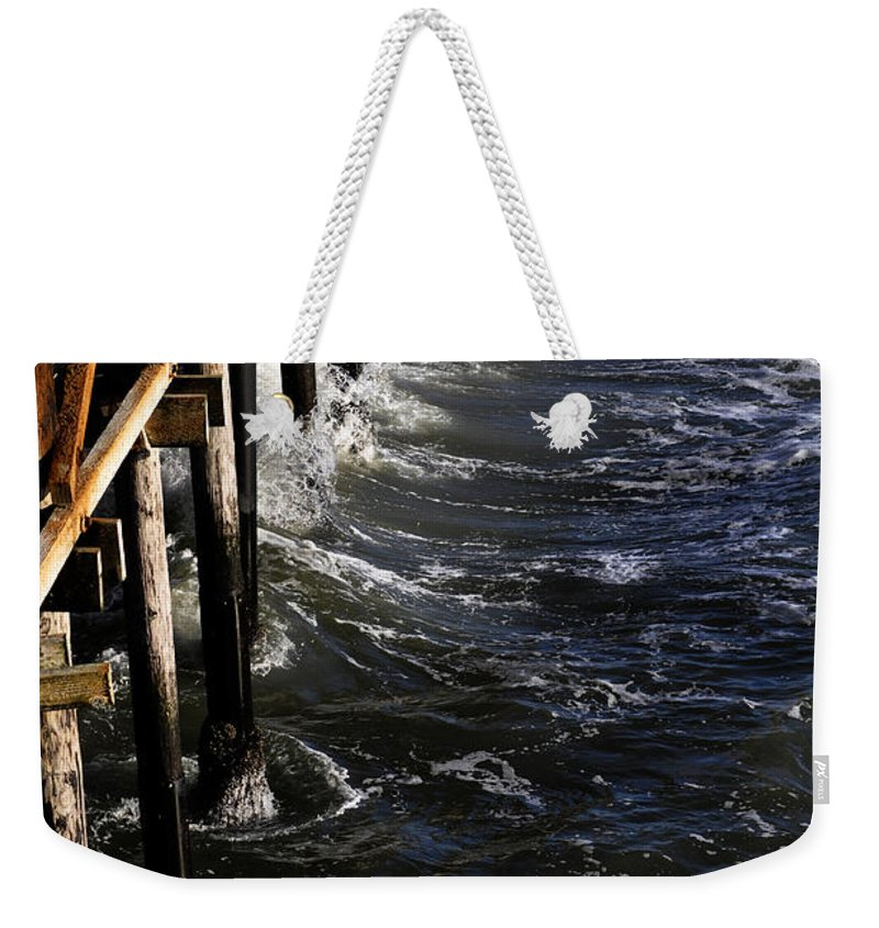 Clay Weekender Tote Bag featuring the photograph Waves Hitting Santa Monica Pier by Clayton Bruster