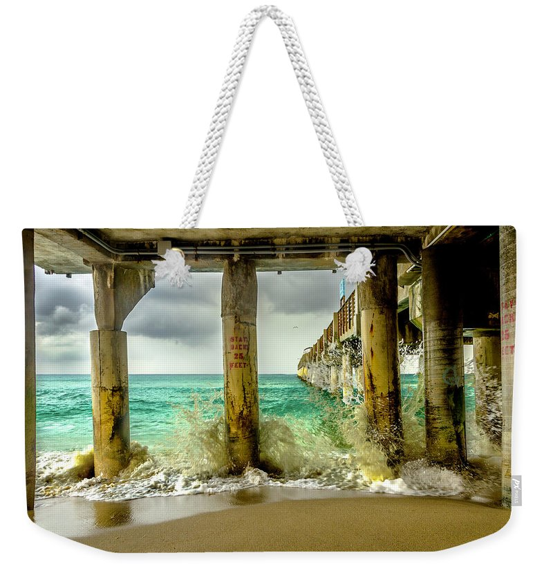Pier Weekender Tote Bag featuring the photograph Waves Smash Into The Pier by Wolfgang Stocker
