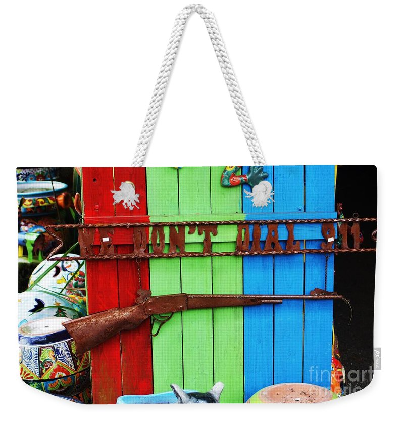 Rifle Weekender Tote Bag featuring the photograph We Dont Call 911 by Chuck Hicks