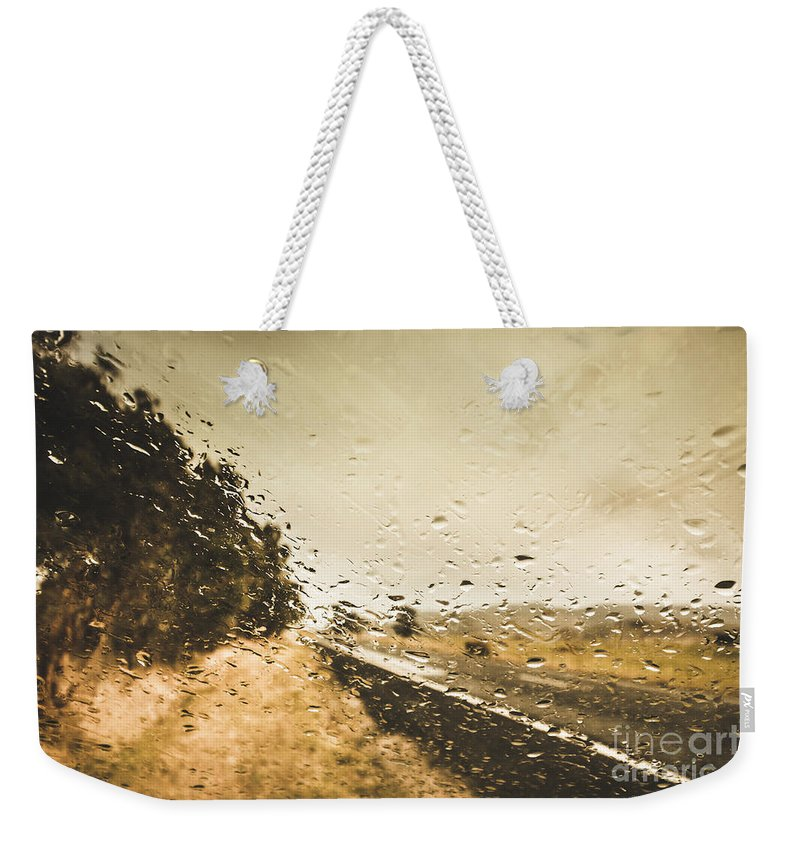 Driving Weekender Tote Bag featuring the photograph Weather Roads by Jorgo Photography - Wall Art Gallery