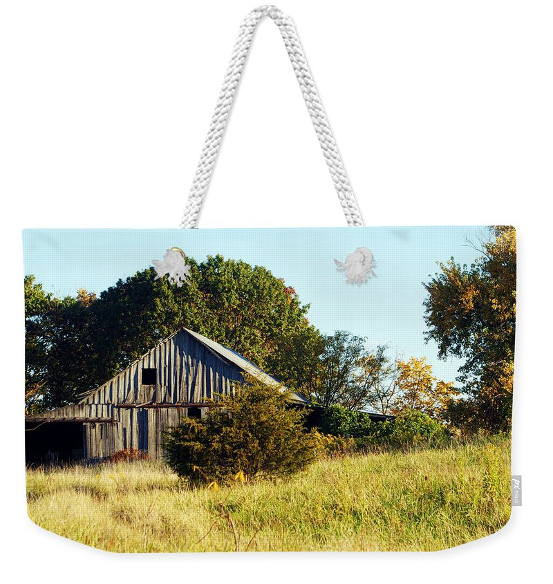 Barn Weekender Tote Bag featuring the photograph Weathered Barn In Fall by Cricket Hackmann