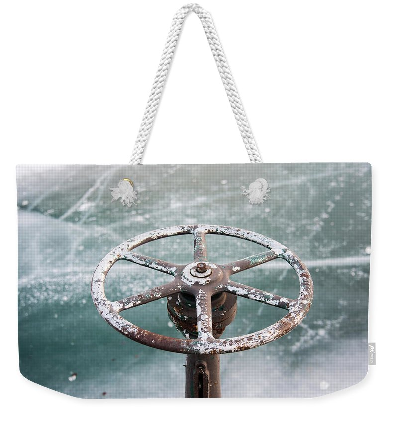 Wheel Weekender Tote Bag featuring the photograph Weathered Metal Valve On Ice by David Prahl