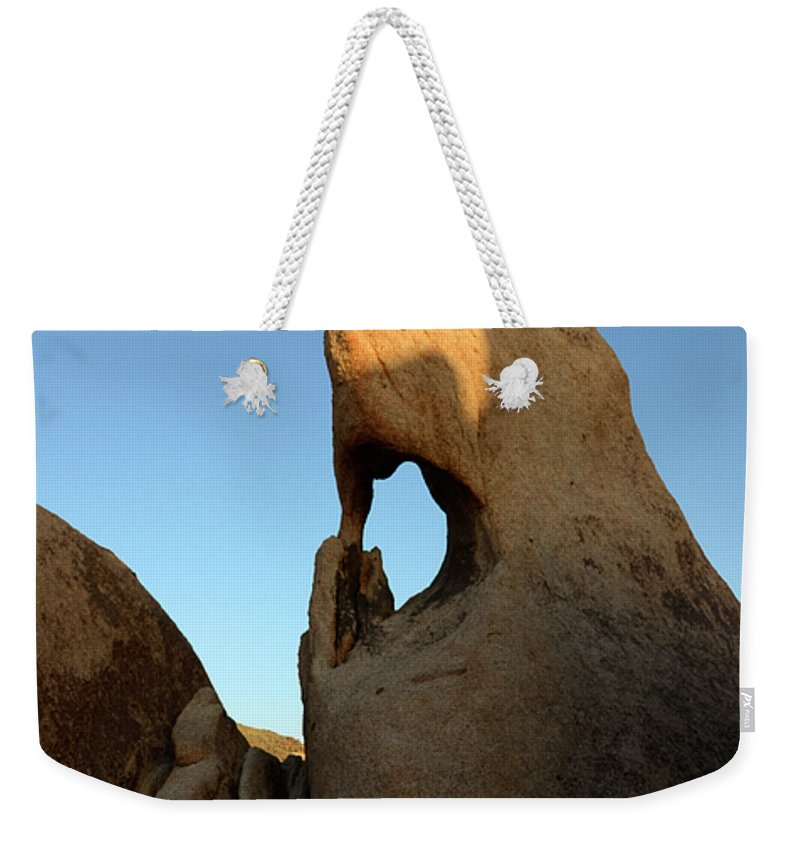 Arch Weekender Tote Bag featuring the photograph Weathered Rock by Bob Christopher