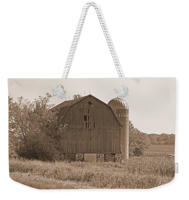 Barn Weekender Tote Bag featuring the photograph Weathered Wisconsin Barn In Sepia by Kay Novy