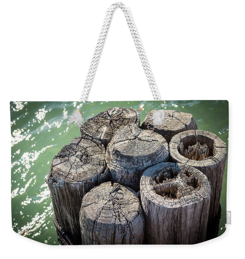 Bank Weekender Tote Bag featuring the photograph Weathered Wood Pier Posts In Lake Michigan by David Prahl
