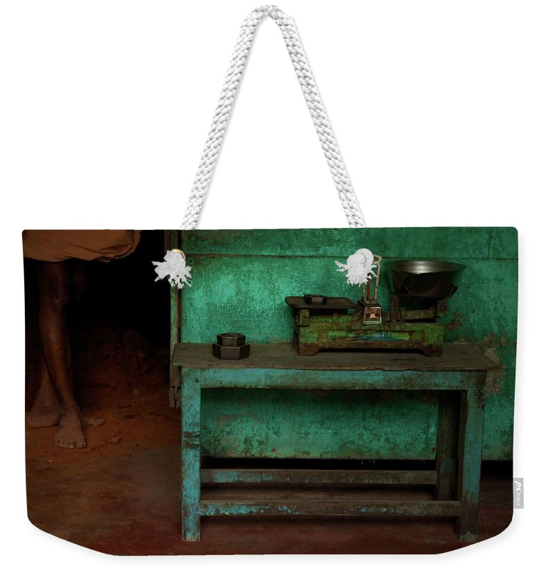 India Weekender Tote Bag featuring the photograph Weighing It Out by Valerie Rosen