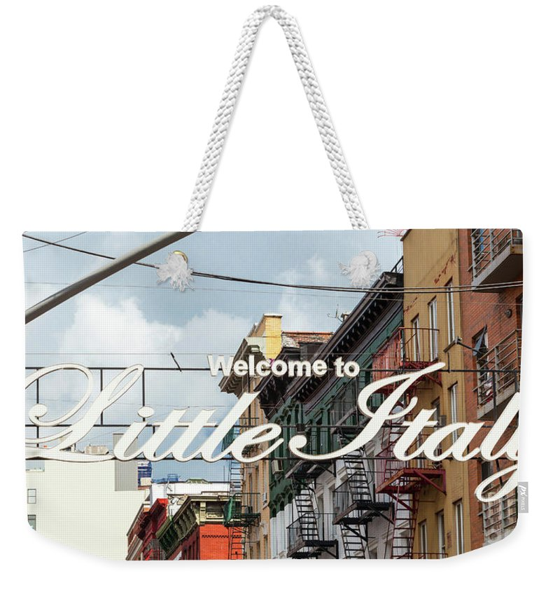 America Weekender Tote Bag featuring the photograph Welcome To Little Italy Sign In Lower Manhattan. by Antonio Gravante
