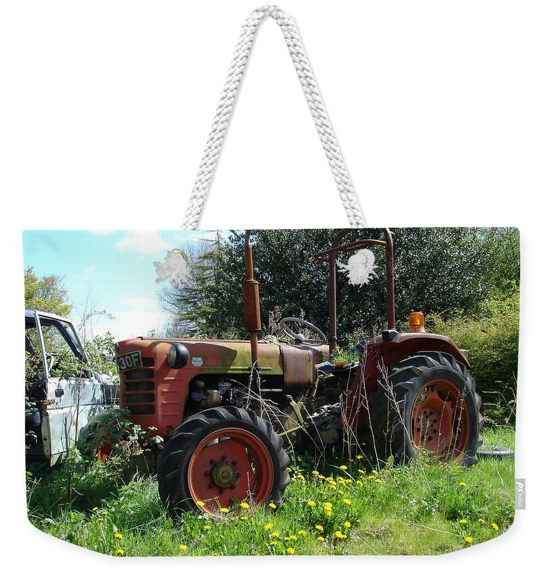 Tractor Weekender Tote Bag featuring the photograph Well And Truely Retired by Susan Baker