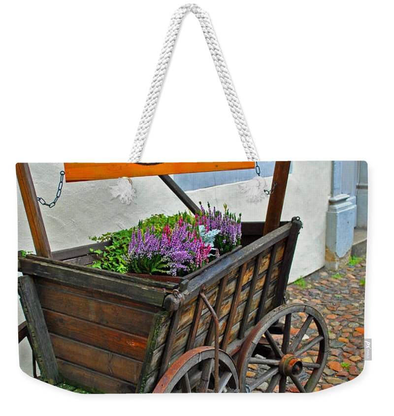 Wittenberg Weekender Tote Bag featuring the photograph Weltladen Cart by Jost Houk