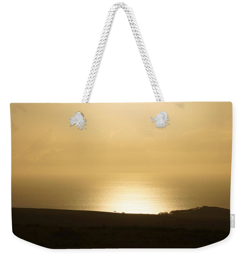 Molokai Weekender Tote Bag featuring the photograph West Molokai Evening by Kevin Smith