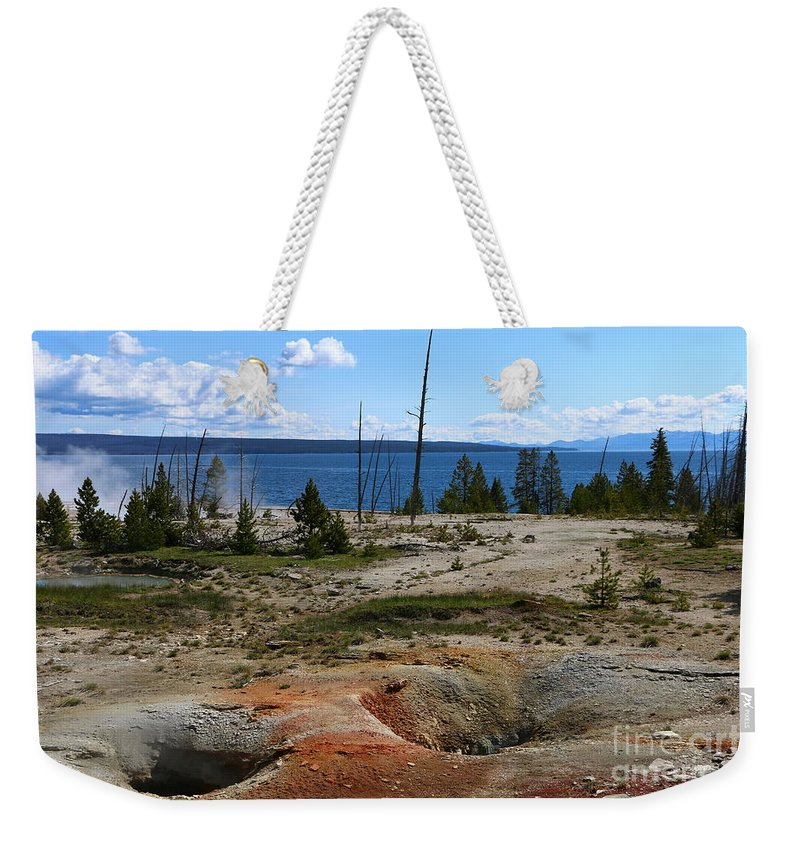 Sunlight Weekender Tote Bag featuring the photograph West Thumb Geyer At Yellowstone Lake by Christiane Schulze Art And Photography