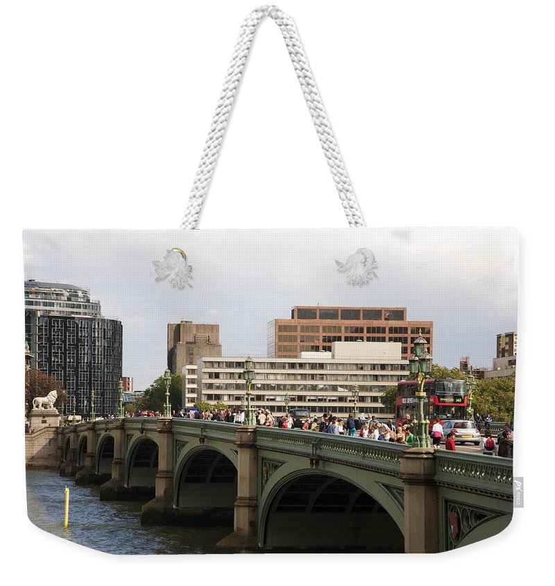 Westminster Weekender Tote Bag featuring the photograph Westminster Bridge. by Christopher Rowlands
