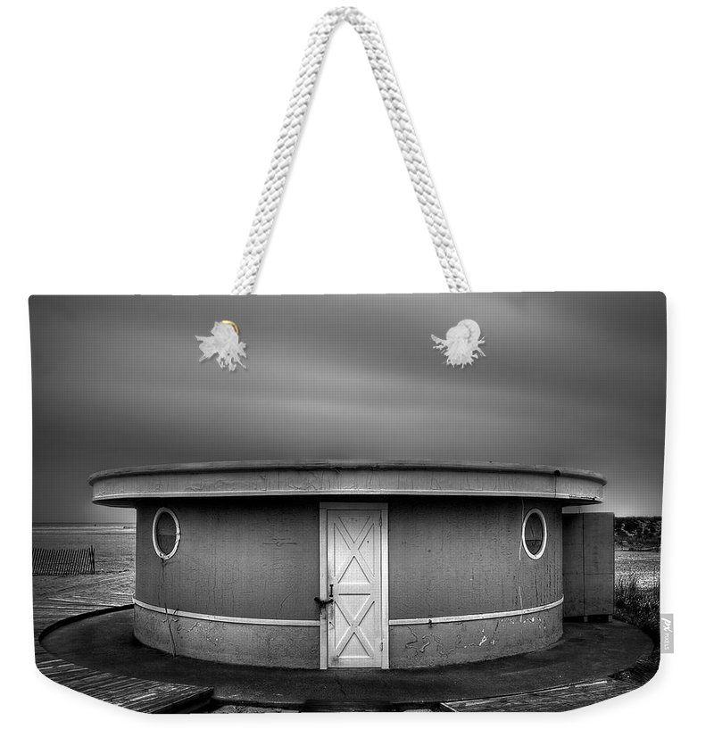 Beach Weekender Tote Bag featuring the photograph What Goes 'round Comes 'round by Evelina Kremsdorf