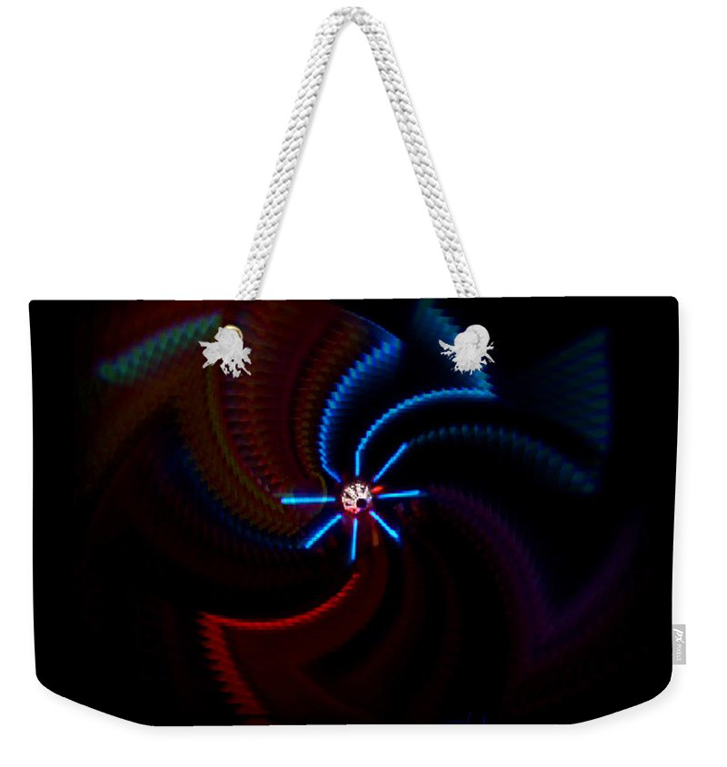 Chaos Weekender Tote Bag featuring the photograph Wheel by Charles Stuart