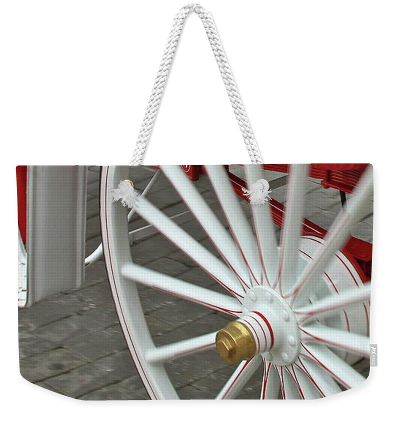 Wheel Weekender Tote Bag featuring the photograph Wheel Motion by Rick Monyahan