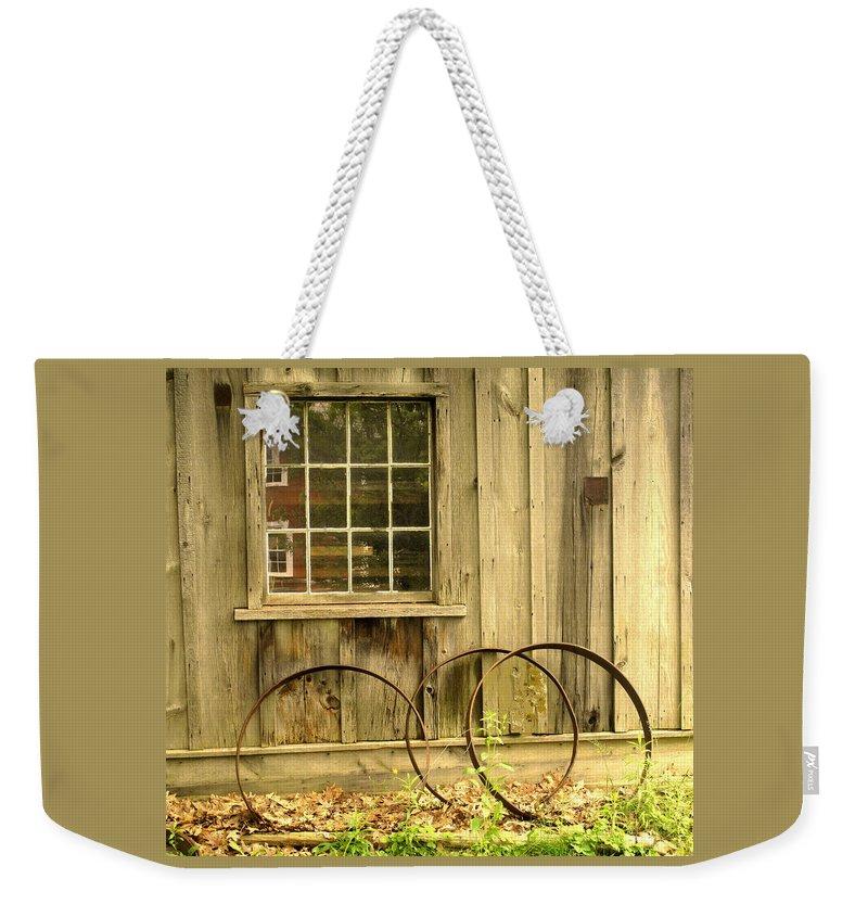 Wheel Rims Weekender Tote Bag featuring the photograph Wheel Rims by Ian MacDonald
