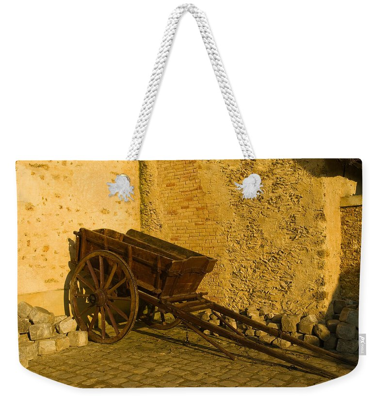 France Weekender Tote Bag featuring the photograph Wheelbarrow by Sebastian Musial