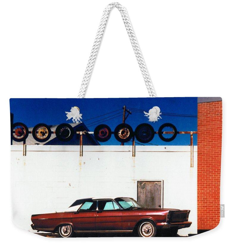 Cars Weekender Tote Bag featuring the photograph Wheels by Steve Karol