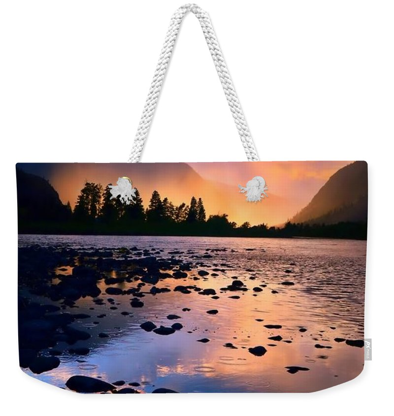 Rocks Weekender Tote Bag featuring the photograph When The Rain Falls And The Sun Sets by Tara Turner