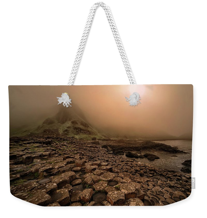 Causeway Weekender Tote Bag featuring the photograph Sunset At Giant's Causeway by Jaroslaw Blaminsky