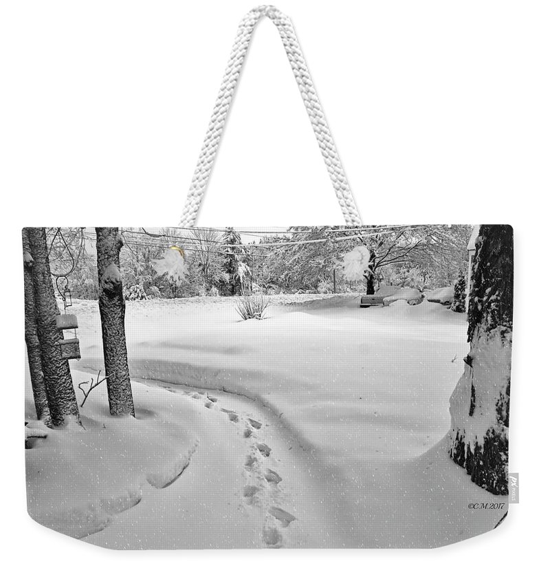 Footprints Weekender Tote Bag featuring the photograph Where The Sidewalk Ends by Catherine Melvin