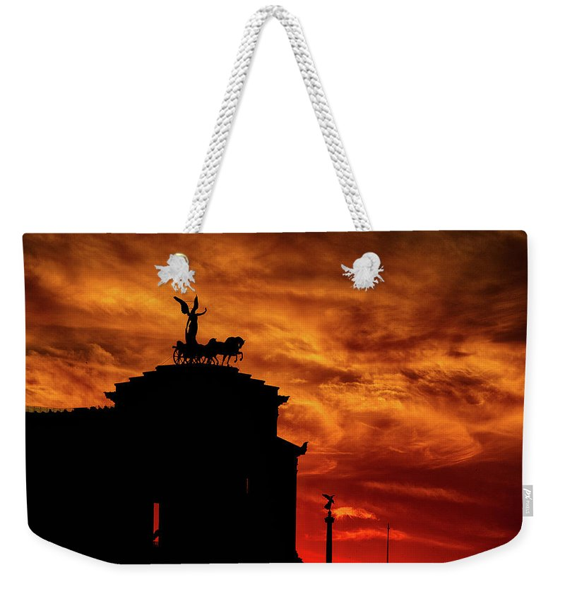 Rome Weekender Tote Bag featuring the photograph While Rome Burns by Rob Davies