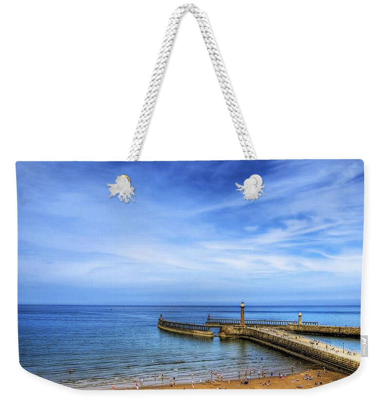 Boat Weekender Tote Bag featuring the photograph Whitby Beach by Svetlana Sewell