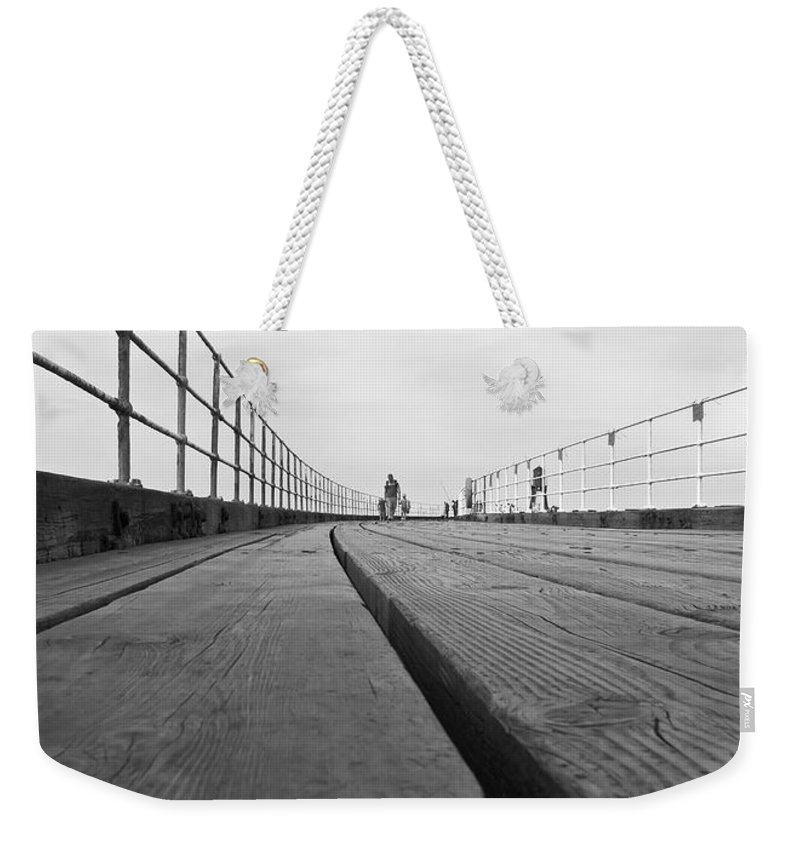 Whitby Pier Weekender Tote Bag featuring the photograph Whitby Pier by Svetlana Sewell