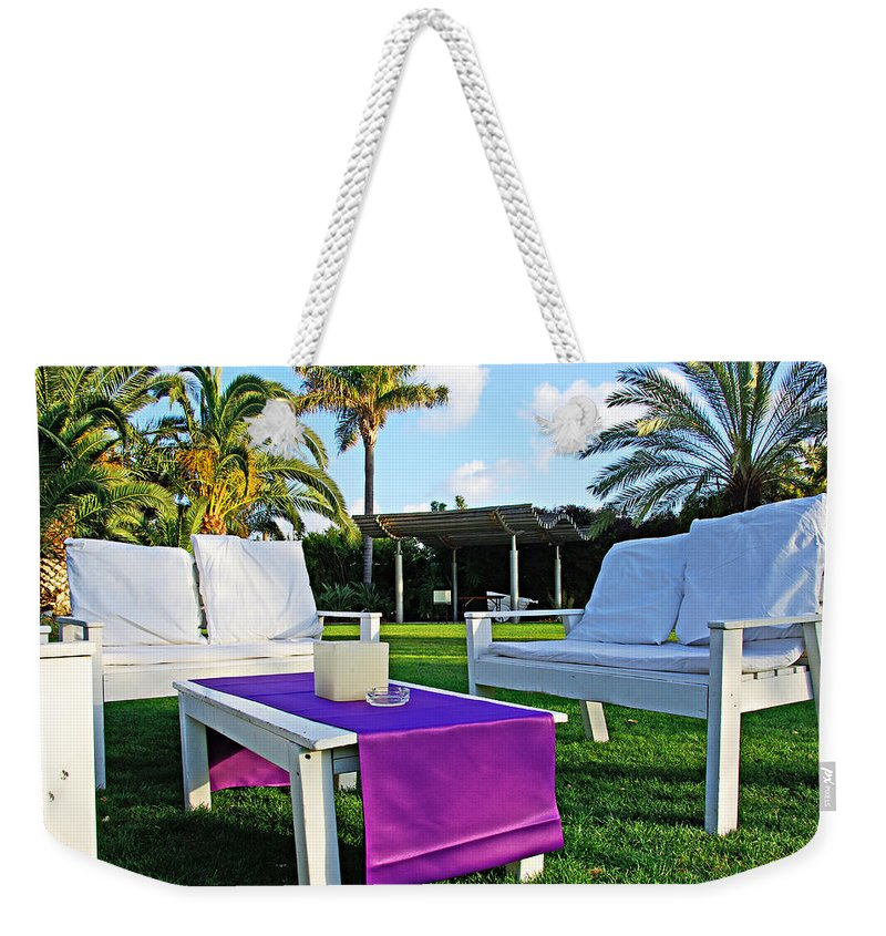 White Weekender Tote Bag featuring the photograph White And Purple by Zal Latzkovich