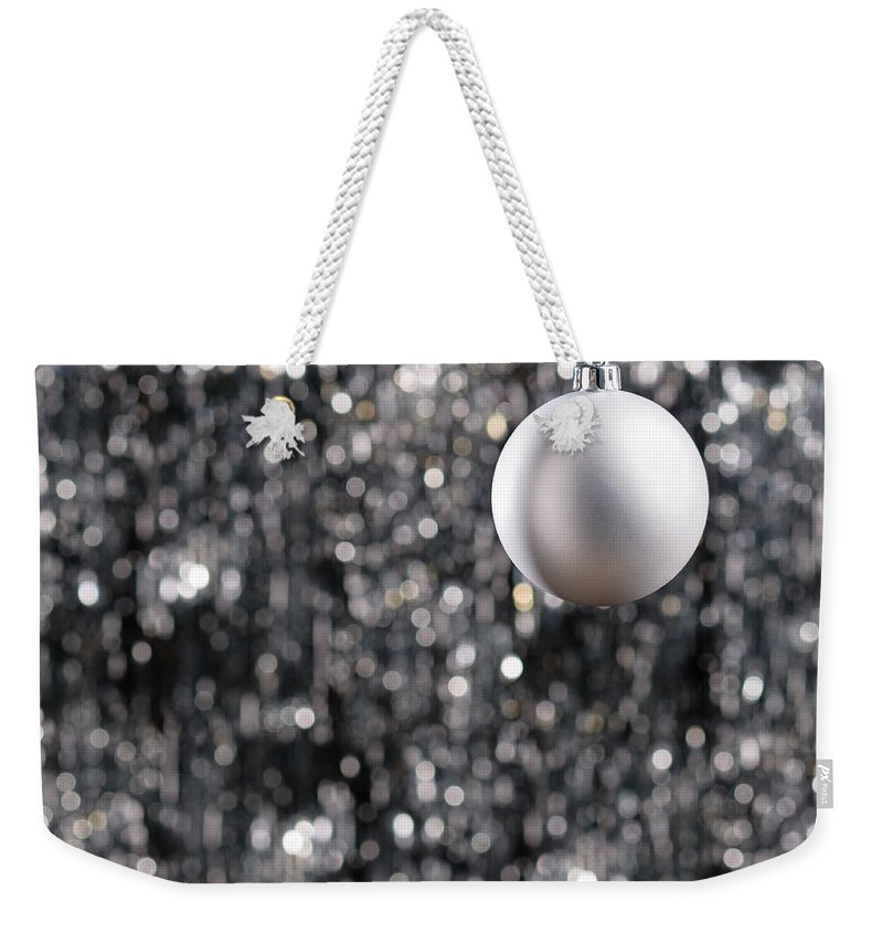 Advent Weekender Tote Bag featuring the photograph White Christmas Bauble by U Schade