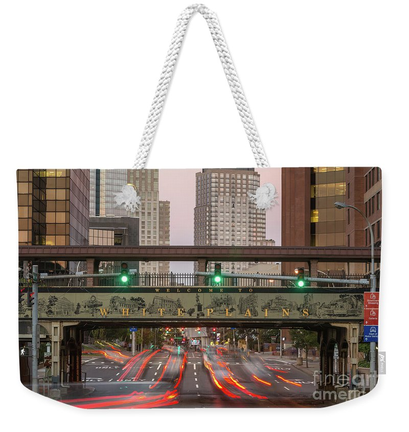 Clarence Holmes Weekender Tote Bag featuring the photograph White Plains Traffic Light Trails IIi by Clarence Holmes