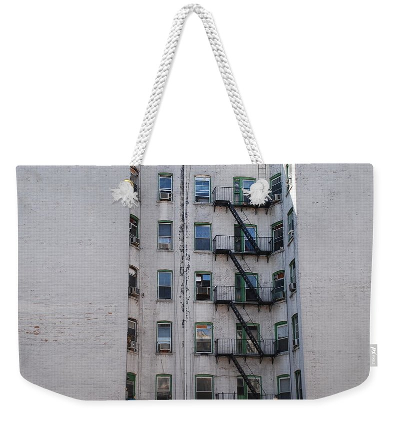 Street Scene Weekender Tote Bag featuring the photograph White by Rob Hans
