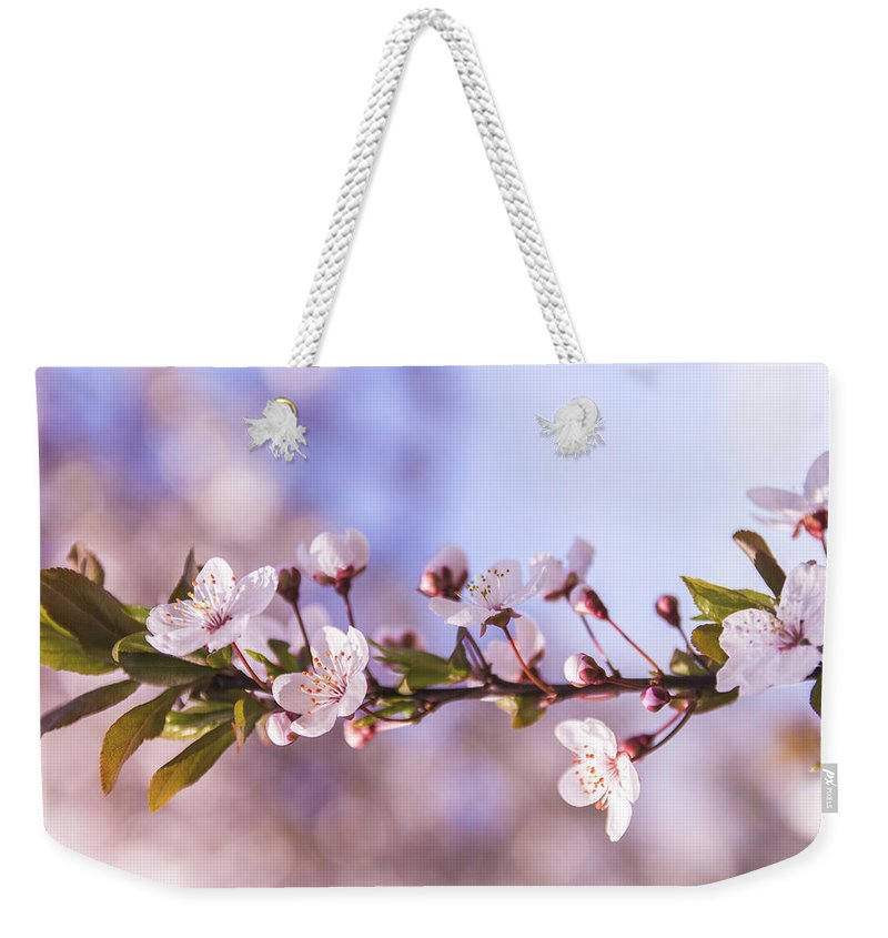 White Weekender Tote Bag featuring the photograph White Spring Flowers by Thubakabra